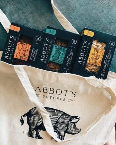 abbot's butcher vegan boxes of chorizo ground beef and chopped chicken on teal background with branded reusable cloth bag