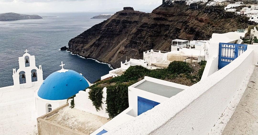 rooftop view from mod santorini overlooking the mediterranean sea church bells cliffs