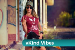 vkind vibes stylish woman in focus vegan af tshirt and peace sign