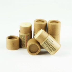 four tubes of newport's naturals lip balm in natural packaging vanilla cupcake and wild berry