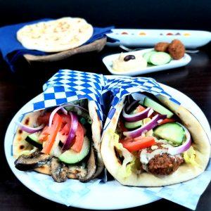 Theano vegan greek and mediterranean cuisine pita wraps with falafel hummus mushrooms olives zuchinni red onion tomato lettuce